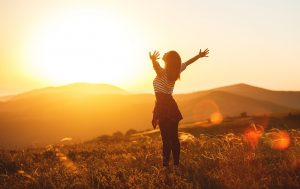 A happy woman spreads her arms as she enjoys the sunset in an open field. This could symbolize the feelings of empowerment and relief that come with women's therapy in Madison, AL. Contact a women's therapist for the support you deserve. We offer transitions counseling, therapy for women, and other services.
